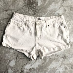 UO Bdg white jean mid rise cuffed shorts